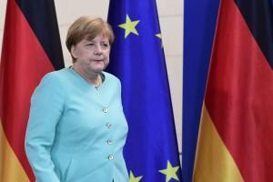 La chancelière allemande Angela Merkel reçoit lundi après-midi le président français François Hollande et le Premier ministre italien Matteo Renzi, à la veille d'un sommet européen capital à Bruxelles. (photo AFP)