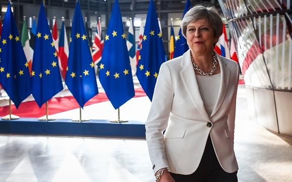 Le Royaume-Uni ne forcera aucun citoyen de l'UE à quitter son territoire après la date effective du Brexit, a assuré Theresa May. (photo AFP)